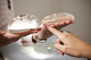 When was the first breast augmentation surgery?
